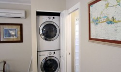 No tiny apartment size washer dryer.  This will do those beach towels and more